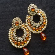 Designer Earrings with Orange and white stones and Orange tear droplets.