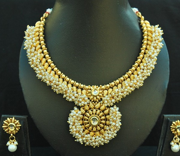 artificial gold tone necklace set with cz and pearls