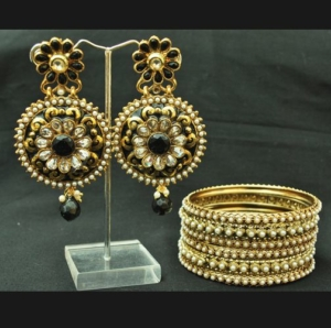 Black alluring earrings with pearl Bangles