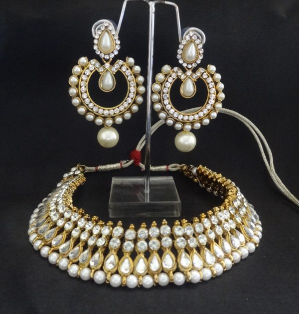 Super elegant Pearl earrings with Pearl and stone studded necklace.