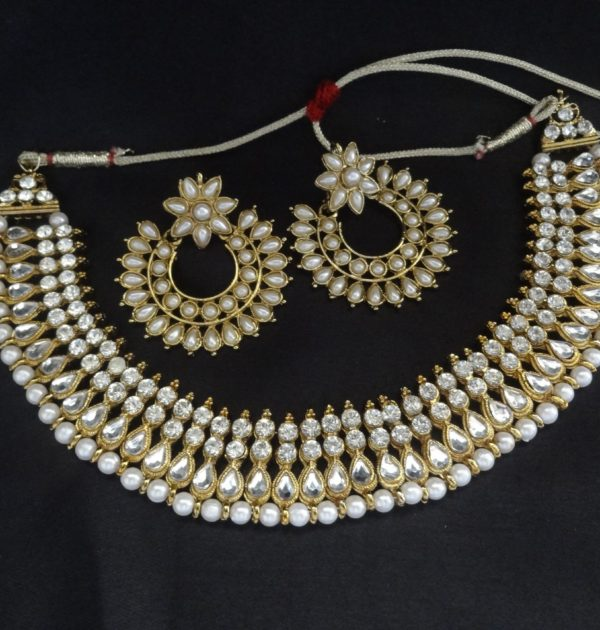 White stone and Pearl studded necklace with floral pearl earrings | Reeti fashions