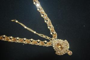 Imitation reeti fashions's bridal jewellery set in gold tone (8 Pieces)