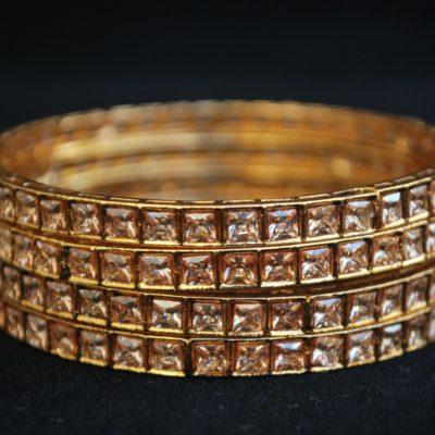 Imitation artificial jewellery gold colour cz copper based bangle