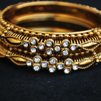 A Pair of Golden Colour White Stone Bangles