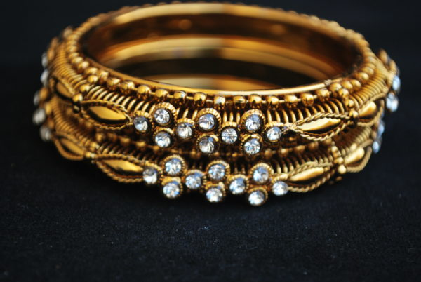 A Pair of Golden Colour White Stone Bangles