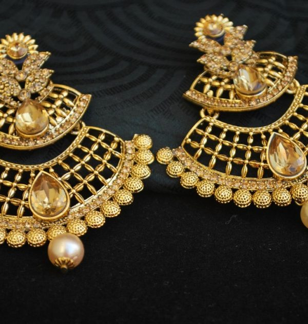 artificial jewellery gold tone long earrings with pearl