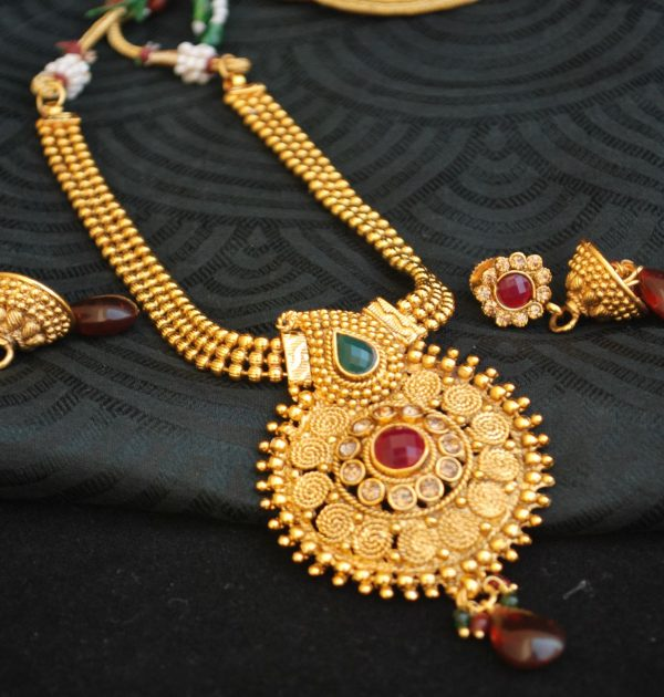 Imitation  reeti fashions – round necklace set with red pearl