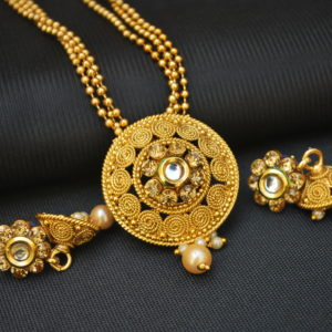 Imitation intricately carved circular motif artificial pendant set with beaded chain-1