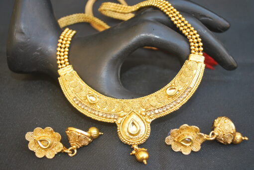artificial gold tone studded necklace set with beaded chain