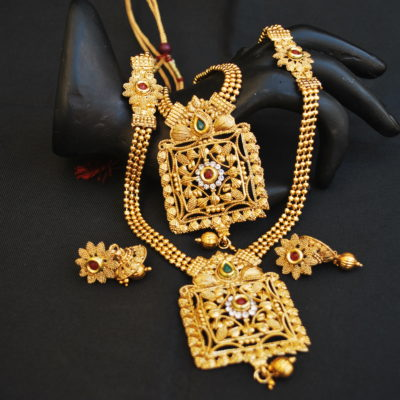 artificial indian traditional green and maroon stone studded square motif layer necklace set