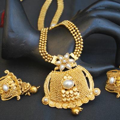 artificial shimmering floral motif gold tone long necklace set