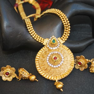 Imitation artificial brilliant gold tone green, maroon and stone studded necklace set