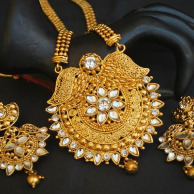 Imitation artificial studded white stone golden long necklace set