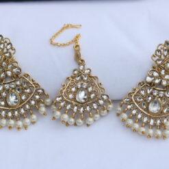 Designer white stone studded earrings with maang tikka