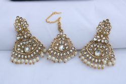 Designer white stone studded earrings with maang tikka