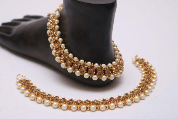 Golden stone studded pearl bridal anklet