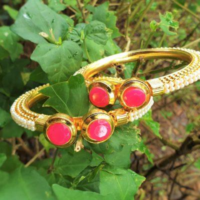 Pink stone studded golden bangles kada style