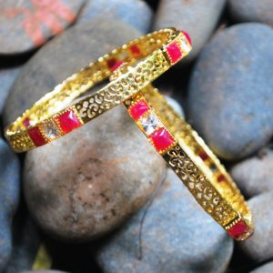 Golden pair of bangles with white and red stones