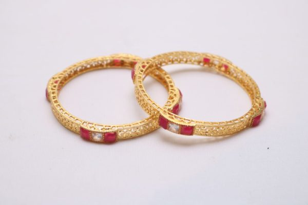 Red and white stone studded golden bangles
