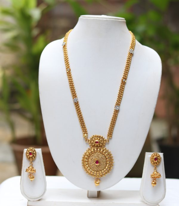 Red stone studded golden long necklace set