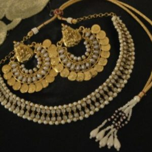 Pearl embellished south indian temple necklace set