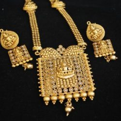artificial flawless long hararm temple jewellery in gold tone