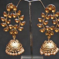 artificial golden leaf motif stone studded jhumki