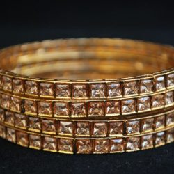 Imitation artificial jewellery gold colour cz copper based bangle
