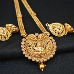 Imitation goddess lakshmi in gold artificial necklace set