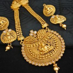 Imitation reeti fashions – golden Laxmi necklace set with white kundan.
